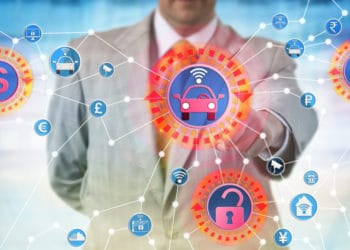 Unrecognizable industrial consultant is presenting a cyber-hijacking attack on autonomous control system for transportation. IT concept for cybercrime aimed at the internet of things and ransomware.