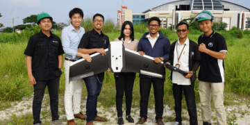 Terra Drone's crew members in Indonesia with the Terra Wing drone. PHOTO from Terra Drone
