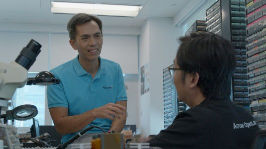 CY Wong, Platysens CEO chats with an Arrow Open Lab staff member.